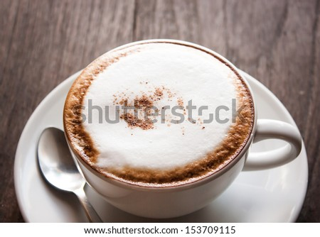 a cup of coffee on the wooden floor or table #153709115