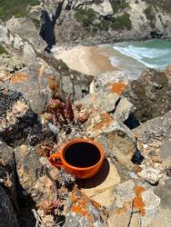 a cup of coffee overlooking the atlantic ocean