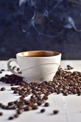 a cup of coffee ; Roasted beans pattern background for cafe, coffee shop,lover on the white wooden table