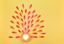 A cup of coffee. Spring floral background with space for text. Floral background. Flowers and coffee. Flowers and red cup on a yellow background. A cup of coffee with petals on a yellow background.