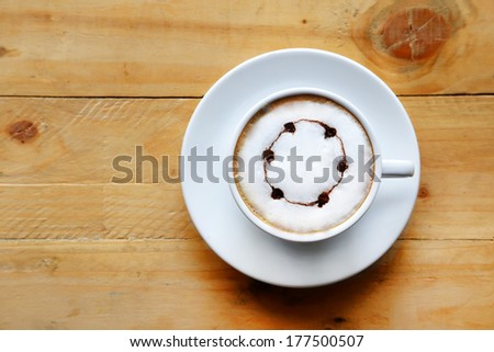 A cup of coffee white cup on wooden background.