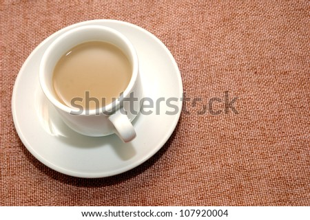 a cup of coffee with creamer