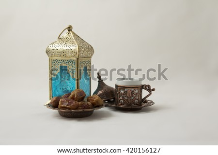 A Cup of coffee with Dates and a Copper Lantern