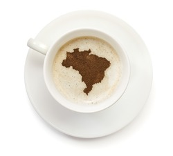 A cup of coffee with foam and powder in the shape of Brazil.(series)