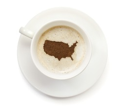 A cup of coffee with foam and powder in the shape of USA.(series)
