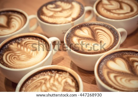 A cup of coffee with heart latte art on top