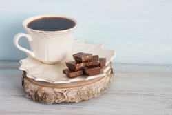 A cup of coffee with pieces of chocolate. Breakfast.