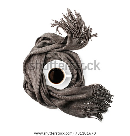 A cup of coffee  wrapped in scarf. Autumn or Winter concept.  flat lay, top view