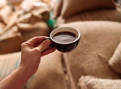 a cup of delicious fresh roasted coffee in coffee warehouse