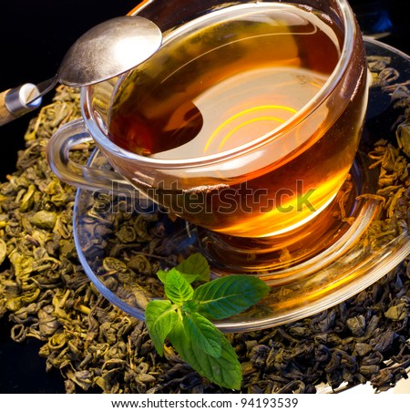 A cup of english green tea with mint