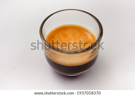 A cup of espresso coffee on a clean white background Foto d'archivio ©
