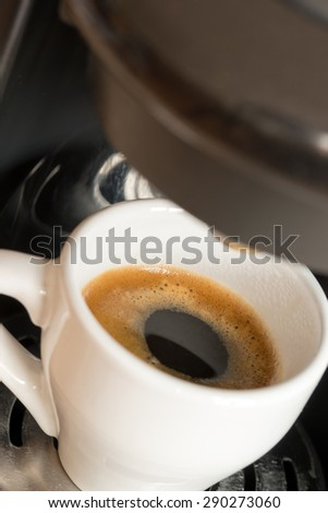 a cup of espresso is brewed / Espresso #290273060