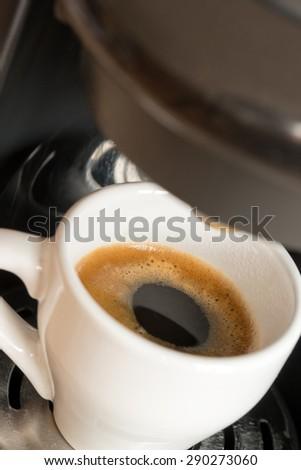 a cup of espresso is brewed / Espresso #290273060