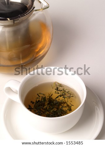 A cup of green tea from a pot