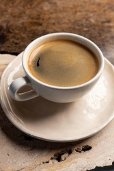 A cup of hot black morning coffee with a vintage marble table. A close up of americano or double espresso. Coffee break.