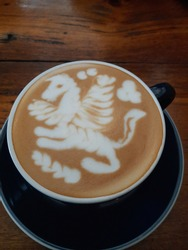 a cup of hot cappucino in the morning with beautiful pegasus