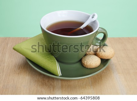 A cup of hot tea with green background