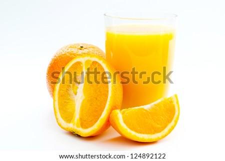 a cup of orange juice and fresh orange