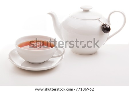 A cup of tea and a teapot - stock photo