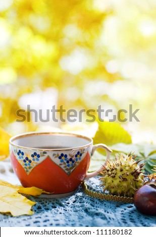 A cup of Tea and autumn leaves