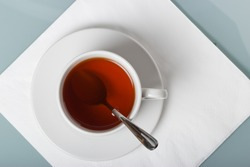 A cup of tea on a napkin. The geometric composition with copy space.