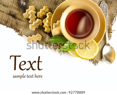 A cup of tea with lemon and crackers