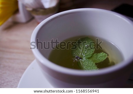 a cup of tea with mint #1168556941