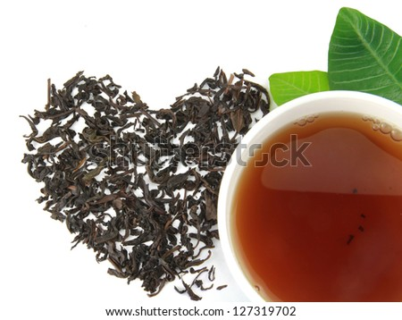 A cup of tea with tea brew heart on a white background
