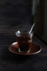a cup of tea with wodden background