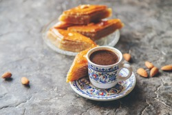 A cup of Turkish coffee and baklava. Selective focus. Drink.