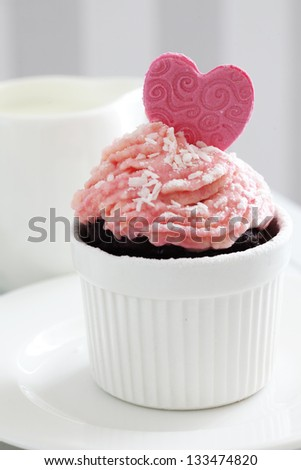 A cupcake on a table lifestyle photo