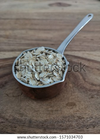 A cupp full of oat meal on wooden background  Stok fotoğraf ©