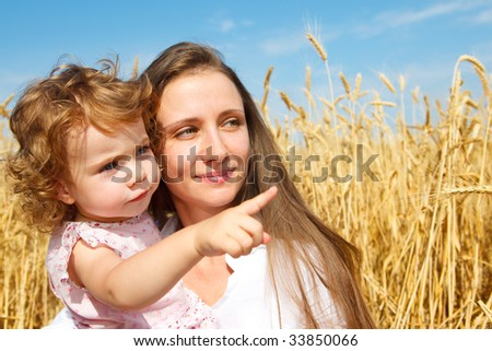 A curly girl showing something to her mother