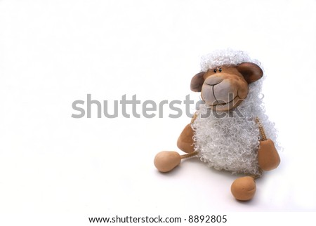 A curly sheep isolated on a white background.