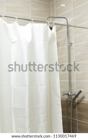 a curtain. shower or bath #1130017469