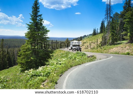 a curved road with RV