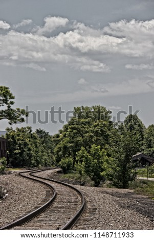 A curving railroad track thru the Laurel Highlands in western PA. I liked the pattern of the slowly curving tracks and the foliage gives a relaxing image of days gone by.  #1148711933