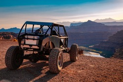 A Custom 4x4 Rock Crawler Off-Roading In The Sandstone Red Rock Terrain Outside Of Moab Utah In The American Southwest
