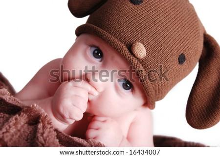 A cute baby boy sucking his thumb