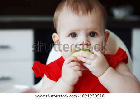 850beee2ea1 Portrait of little girl eating apple close-up Images and Stock ...