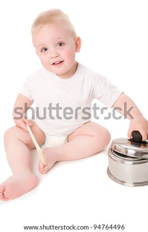 A cute boy with wooden spoon and cooking pot