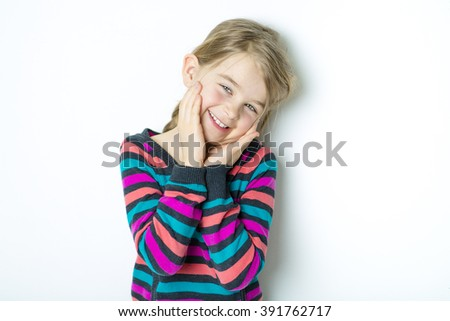 A cute cheerful  little girl portrait, isolated on gray background Stock photo ©