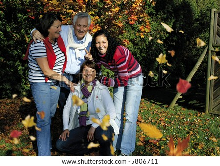 """a cute family is joking in the park. keyword for this collection is """"autumn77"""""""