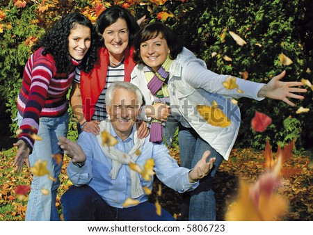 "a cute family is joking in the park. keyword for this collection is ""autumn77"""
