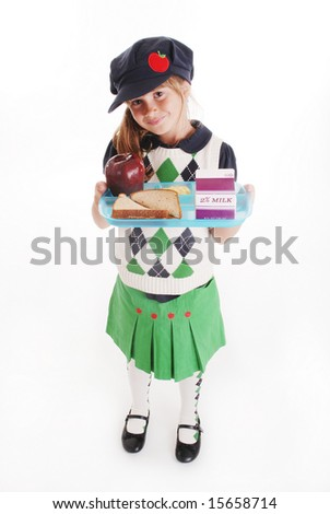 A cute girl holding a lunch tray - stock photo