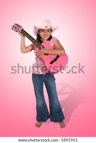 A cute girl in pink playing the guitar