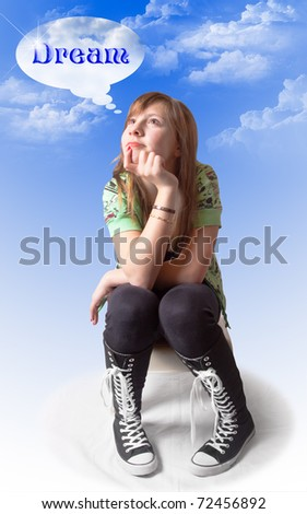 A cute girl sitting and thinking with a dreamy expression; blue sky and clouds background and text of the word DREAM in her thought bubble