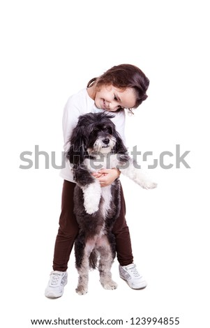 A cute infant girl with her black dog isolated on white background. - stock photo