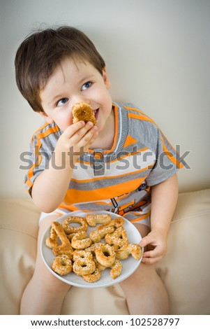 A cute little boy eating a fresh baked cookie