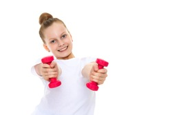 A cute little girl doing exercises with dumbbells. The concept of strength, health and sport. Isolated on white background.